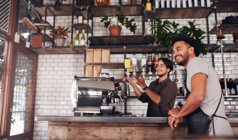 Employees behind a coffee bar providing remarkable hospitality with their POS technology