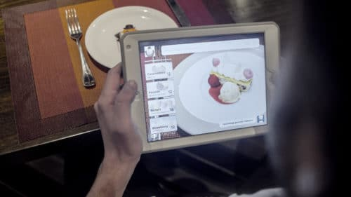 A customer selects a virtual dessert