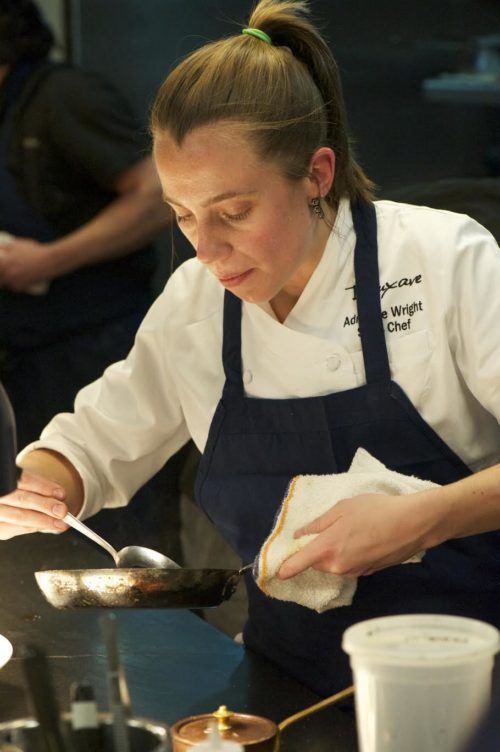 Adrienne Wright cooking in a kitchen