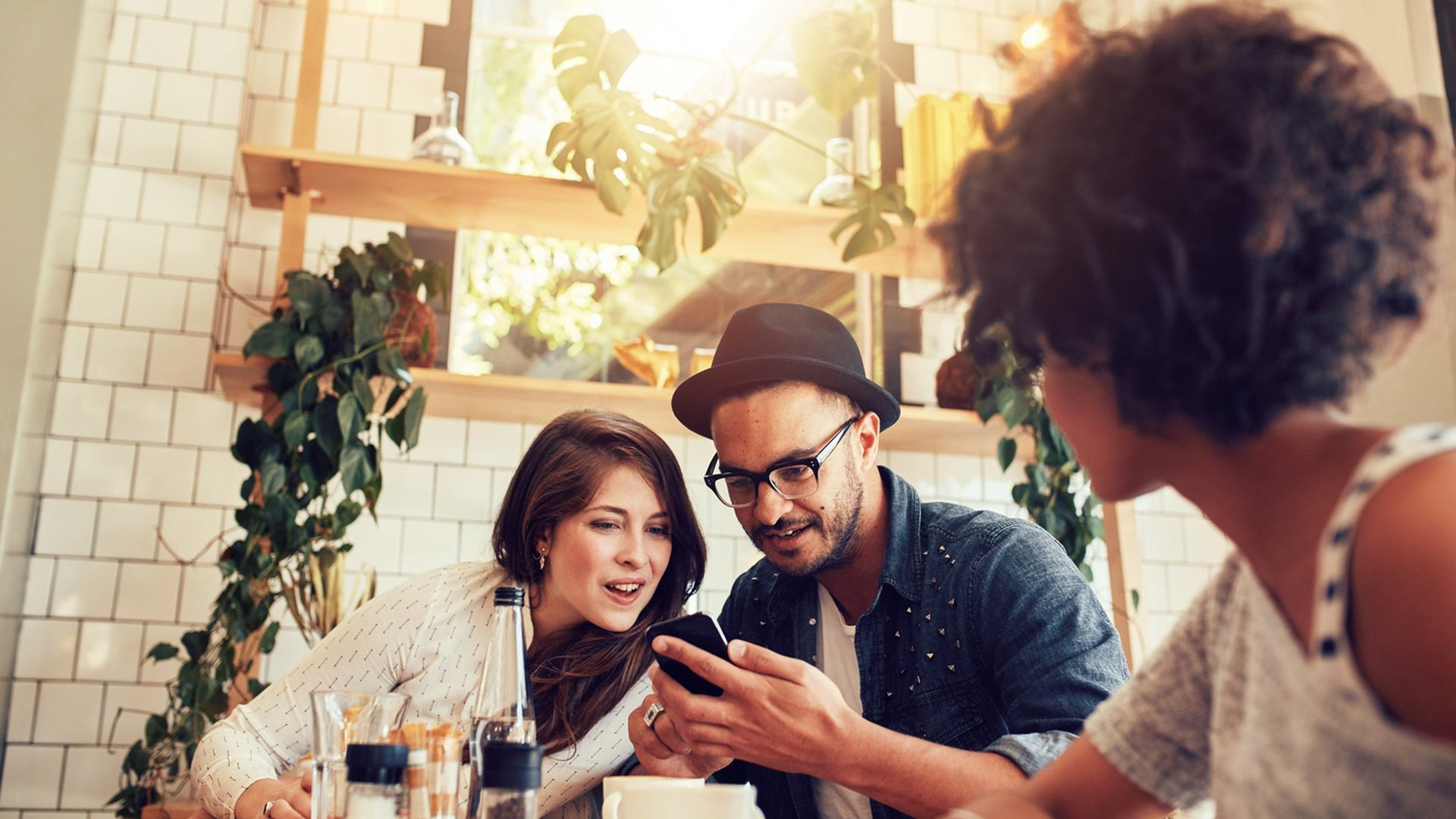 couple with phone at table