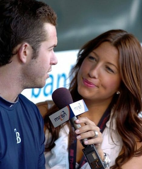 Jen Royle interviewing someone at a sports game