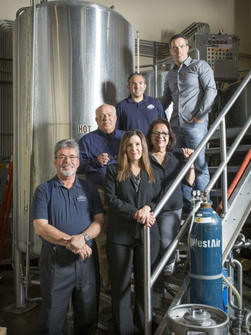 Shawn Hadjis, Oggi's director of operations; Tommy Hadjis, Left Coast Brewing Co. general manager; George Hadjis, Oggi's founder/president; Dora Hadjis, Oggi's CFO; Estella Ferrera, Oggi's vice president; John Hadjis, Oggi's founder/vice president