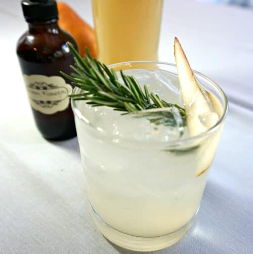 cocktail with a sprig of rosemary