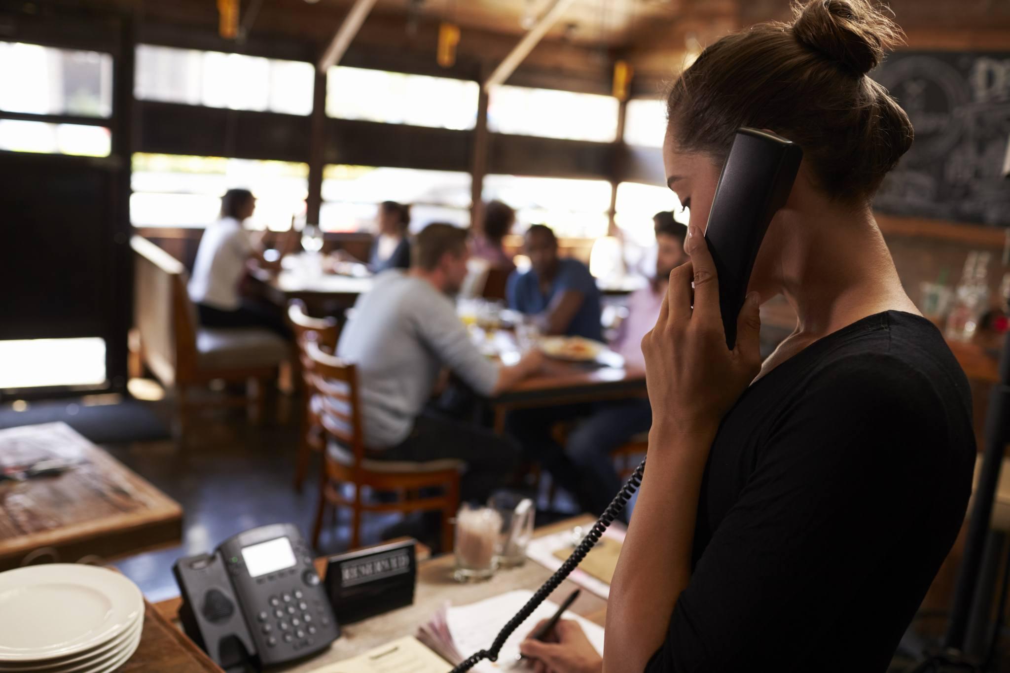 Restaurant server taking phone order