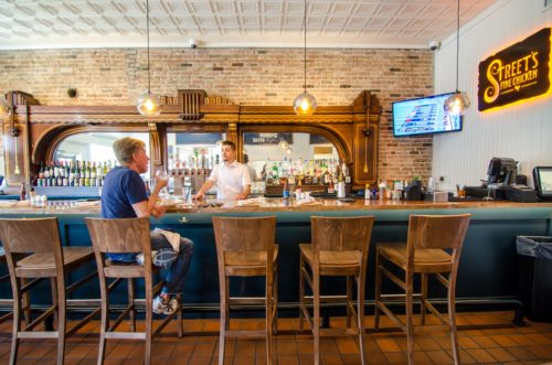 The full-service Street's Fine Chicken has a full bar. Photo Credit: Coeval Studio