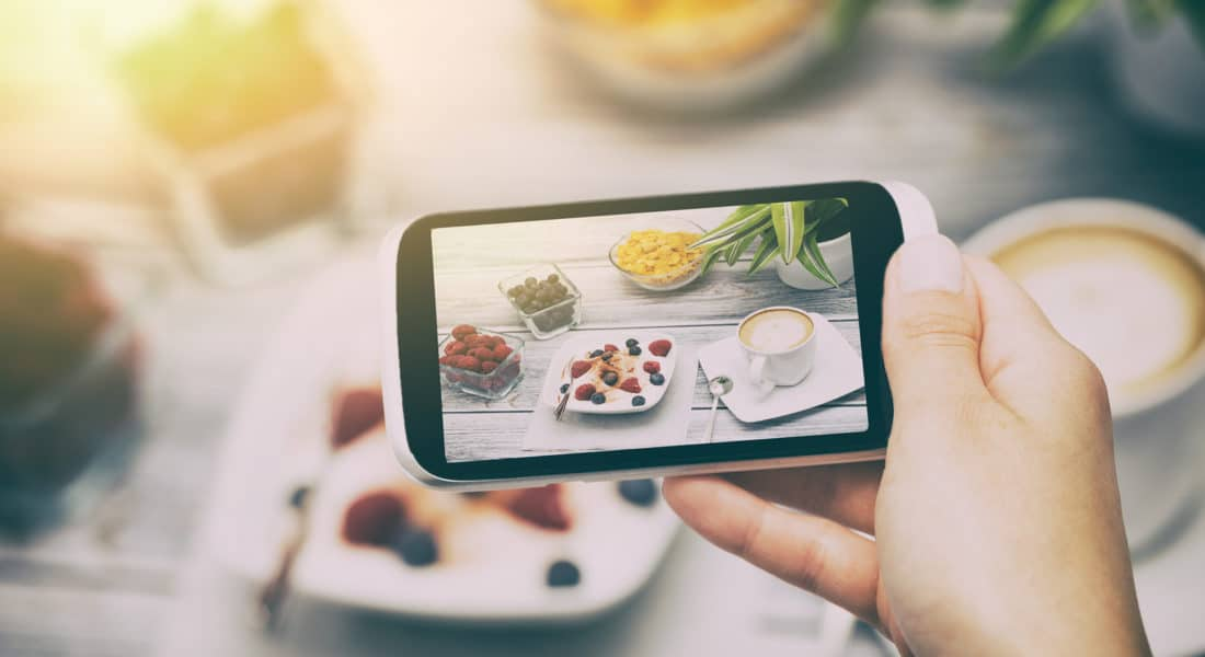 guest taking photo of food for instagram