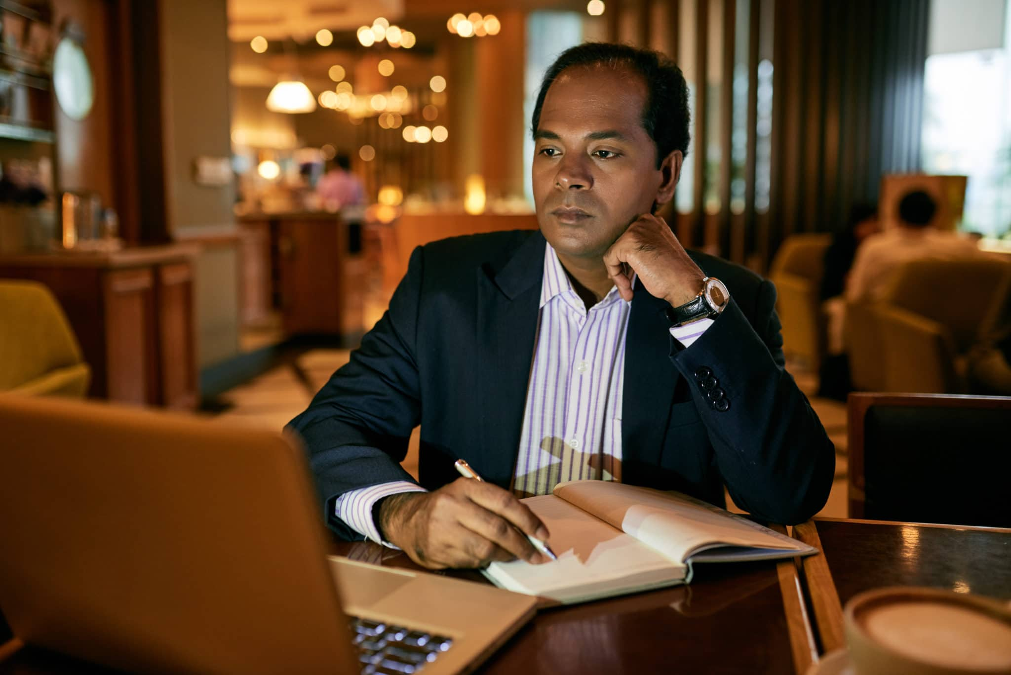 Business executive working on laptop in restaurant
