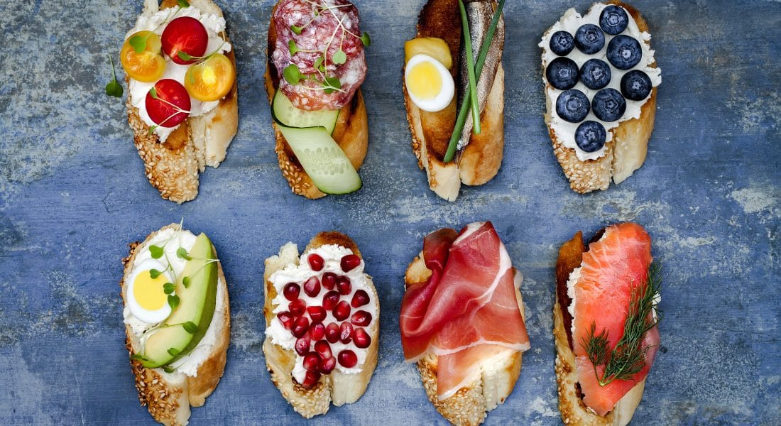 Mini sandwiches food set. Brushetta or authentic traditional spanish tapas for lunch table. Delicious snack appetizer antipasti on party or picnic time. Top view.