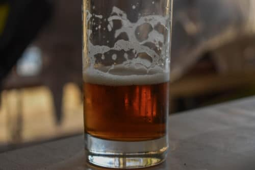 Craft beer. A half-drunk glass of beer at the table restaurant