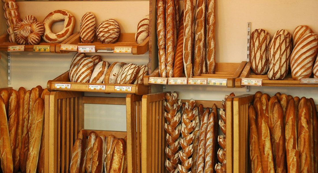 Many different types of bread leaning against a wall in france