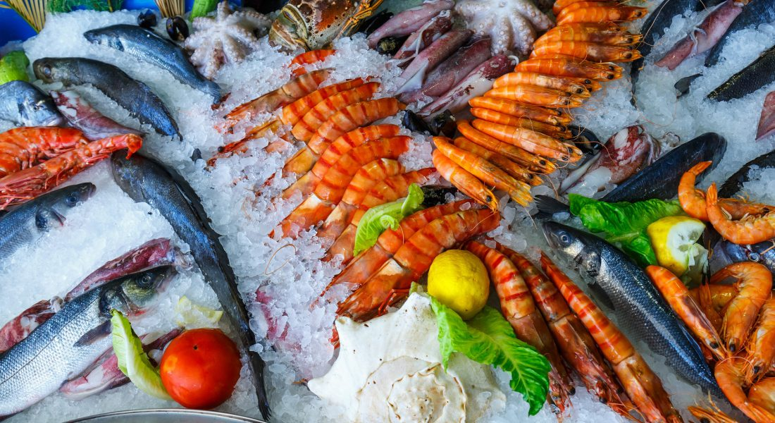 fresh seafood in the fridge of the seafood restaurant in Crete Greece