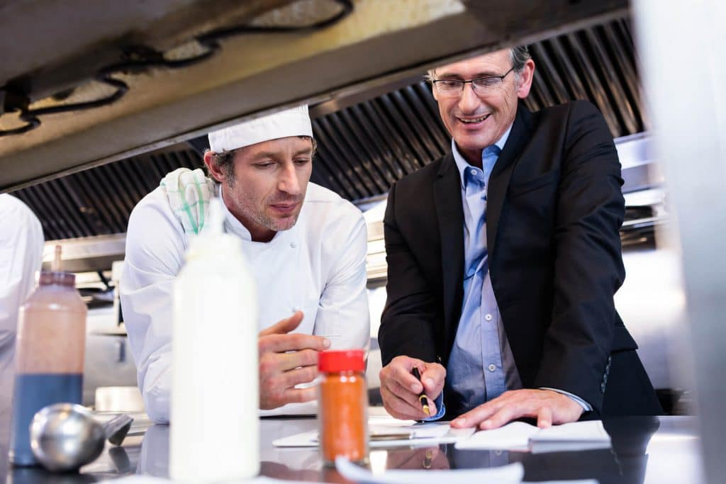 chef and owner discussing restaurant industry trends