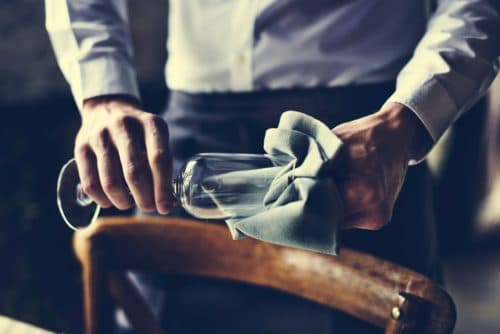 Restaurant Staff Wiping Glass on Table Setting Service for Reception