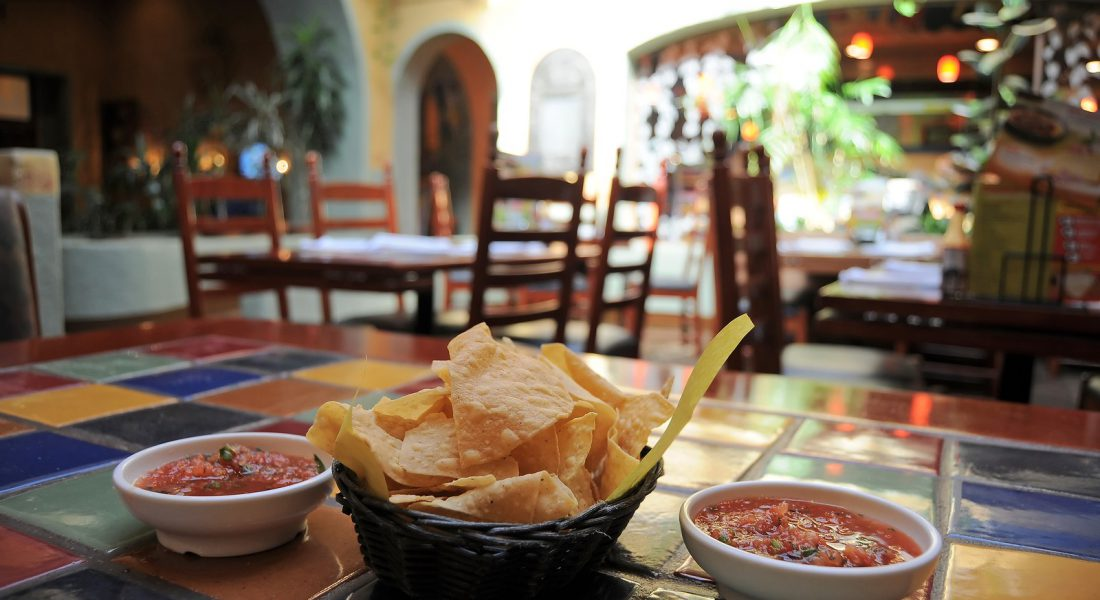 Tortilla chips and salsa in a restaurant
