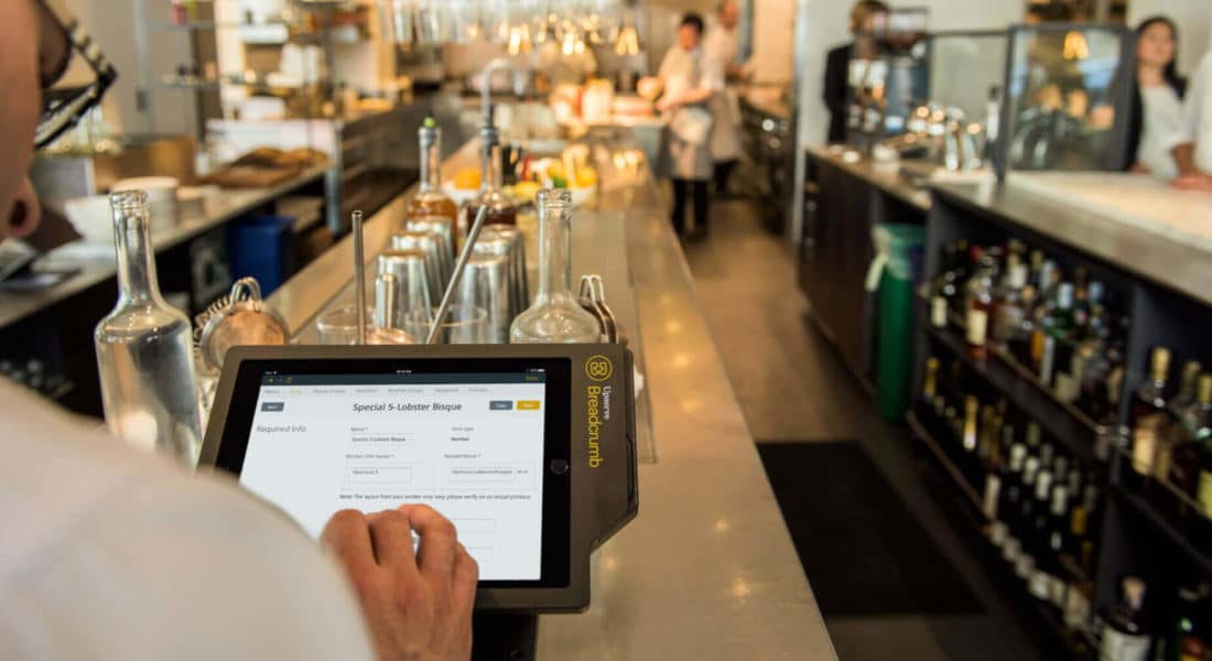 Restaurant owner managing costs on his pos system
