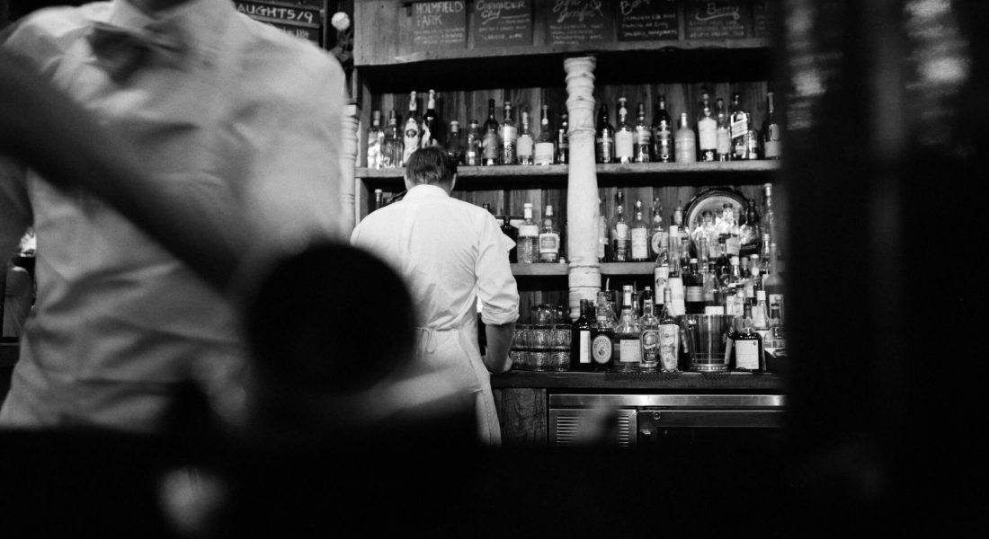 a busy bar in black and white