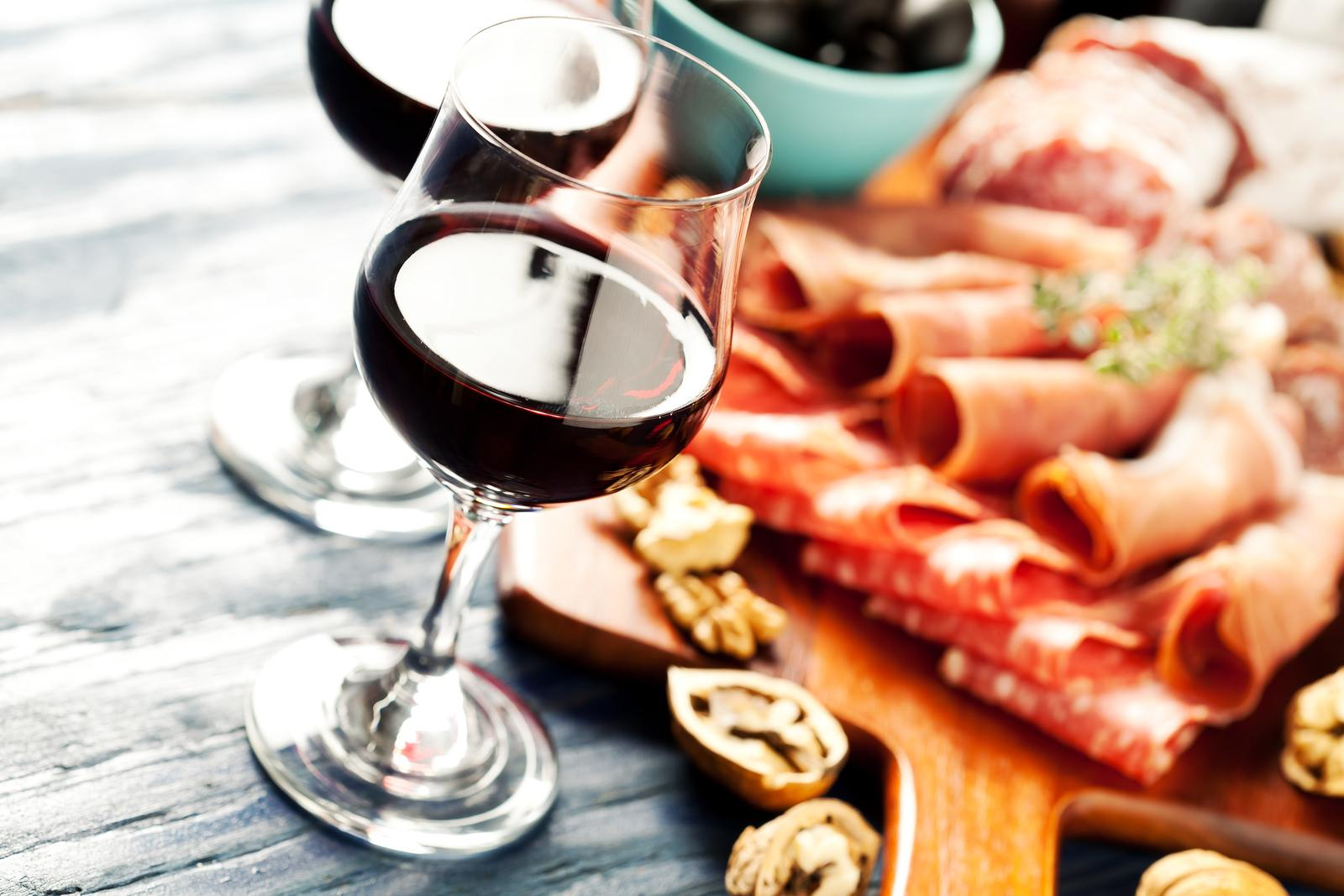 charcuterie board with glass of wine