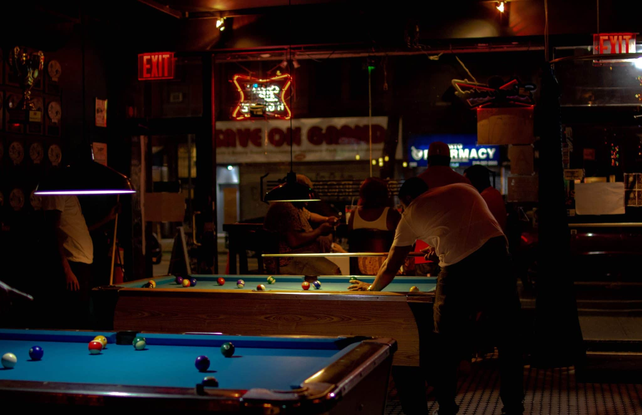 people playing pool at a bar