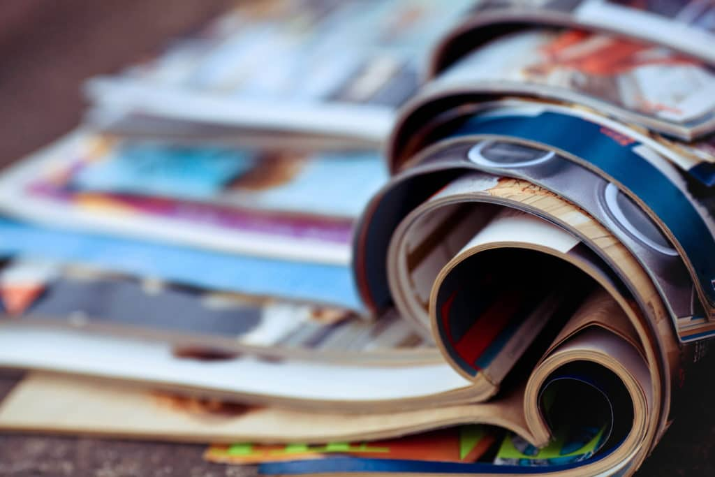 close up stack of restaurant magazines