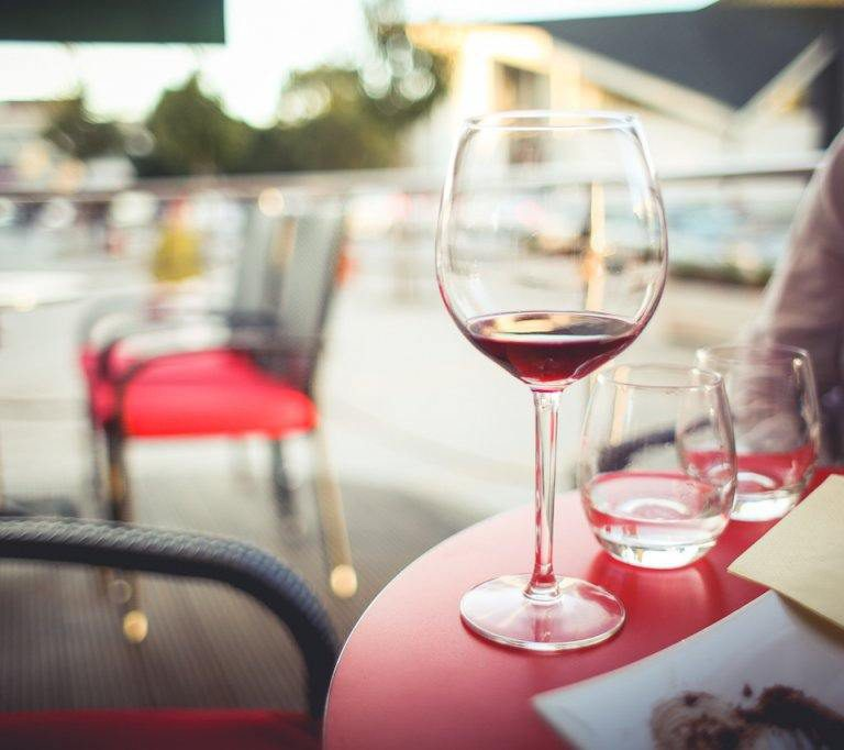 glass of fortified wine on outdoor table