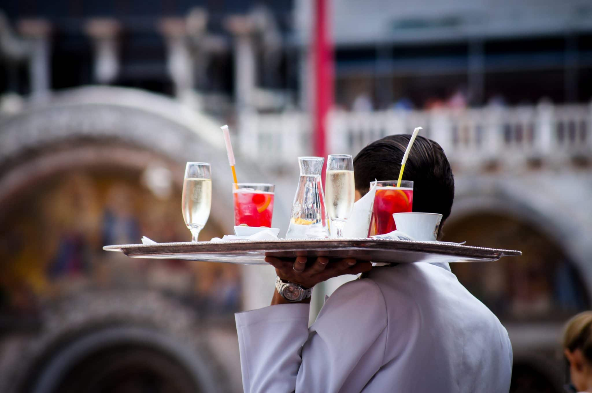 server carrying a tray of drinks
