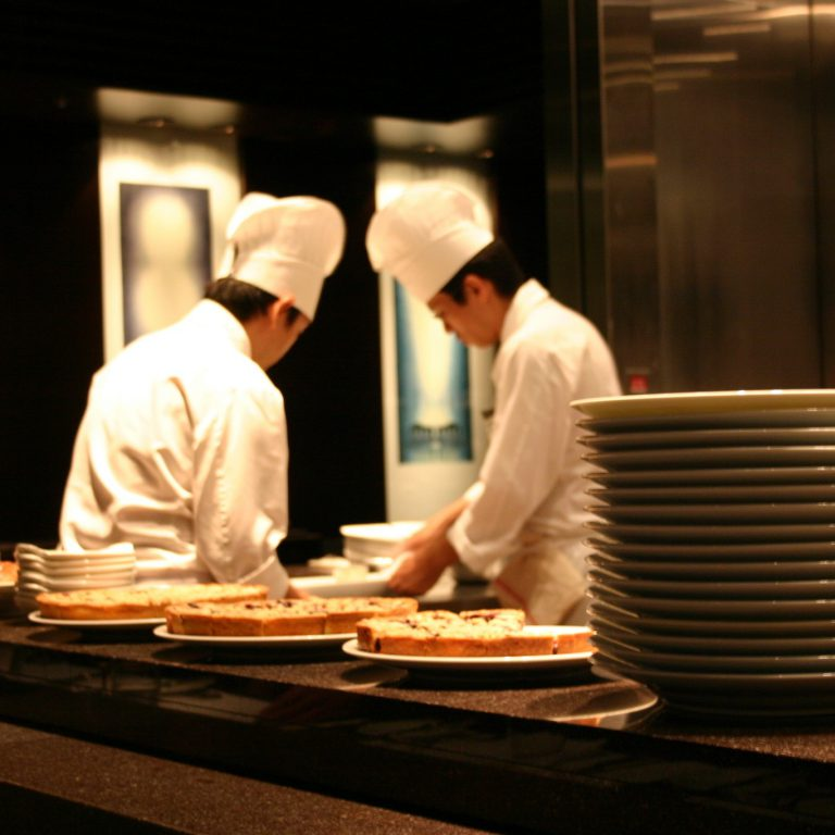 restaurant employees working in a kitchen