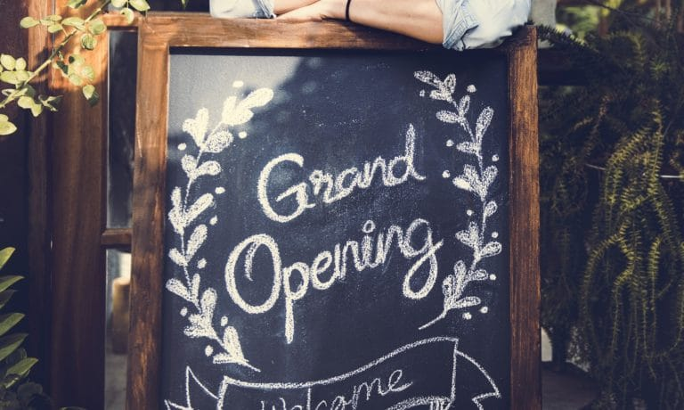 restaurant grand opening sign