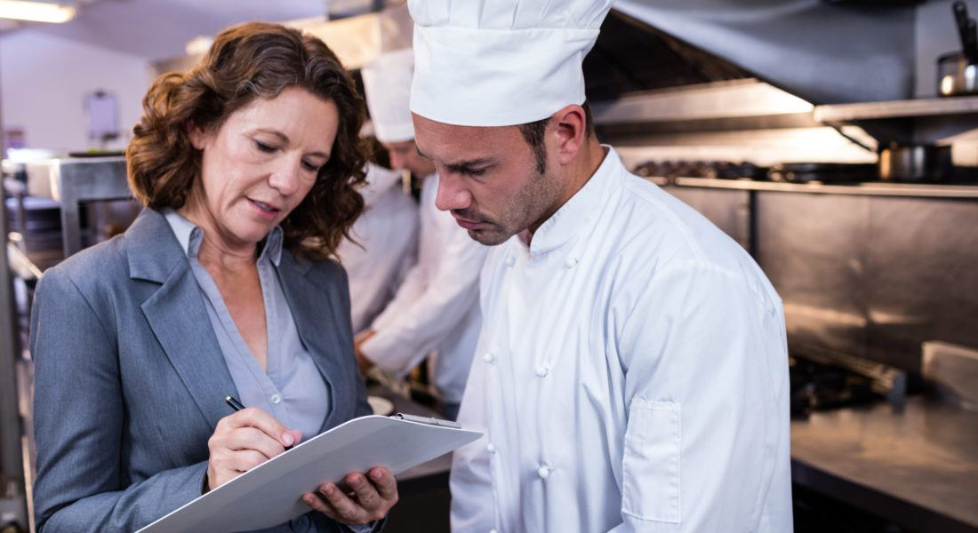 restaurant-manager-and-chef-looking-at-licenses restaurant