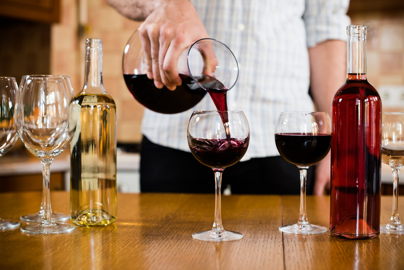 red wine being poured into wine glasses