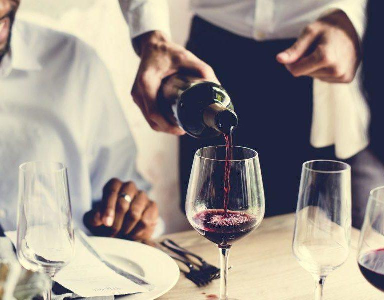 restaurant-staff-pouring-wine