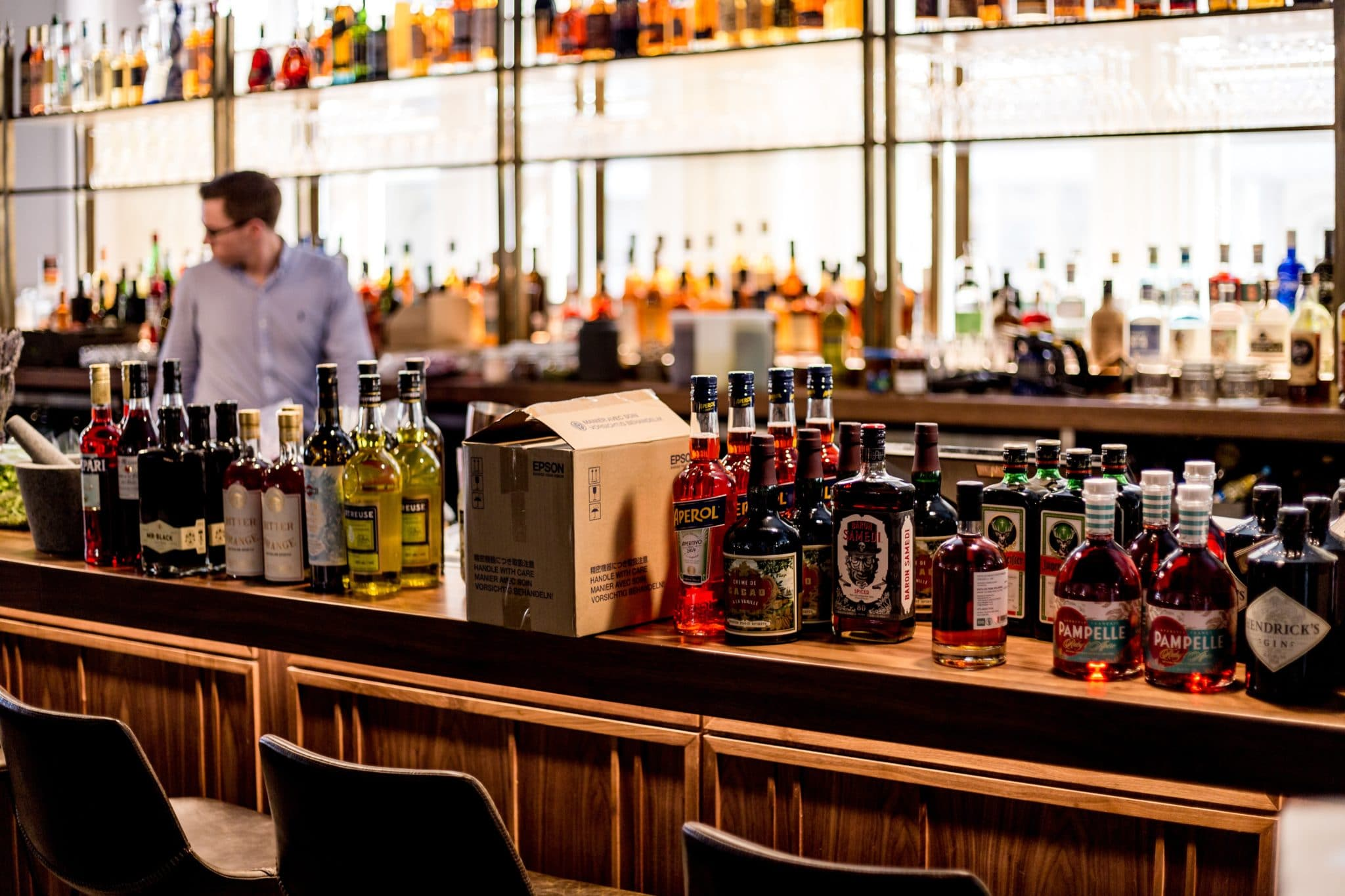 inventory of hard liquor bottles on a bar